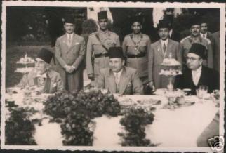 king-farouk-i-prince-mohamed-ali-tawfiq-and-prince-abulmoneim-attending-a-banquet-in-el-kobbeh-palacce-circa-1940.jpg